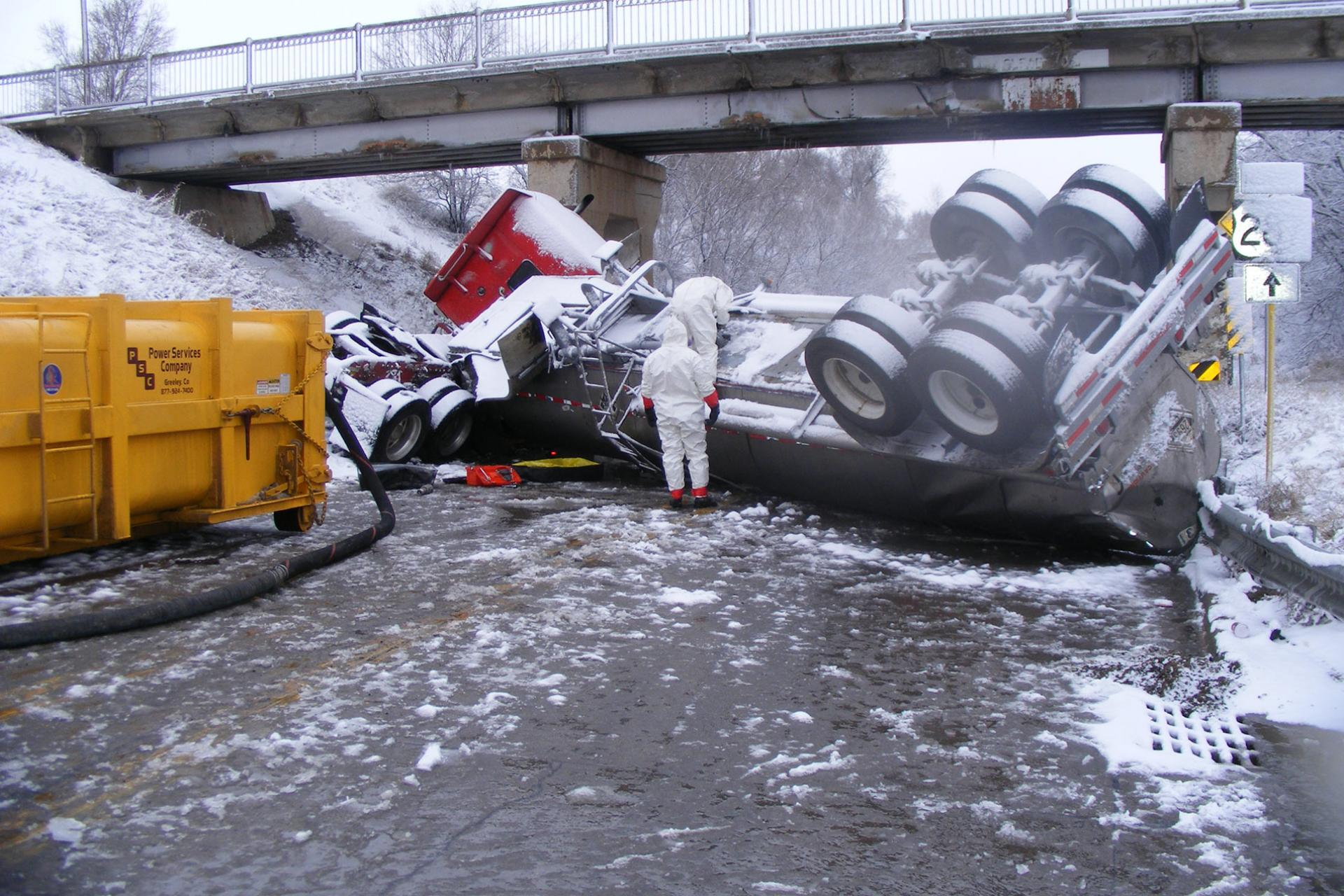 Icy road truck rollover cleanup